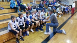 Coach gives the Tigers half time encouragement.