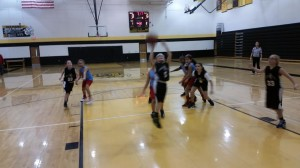 Abby of Inviktus goes up for a lay up vs the Future Lady Cards in 4G action