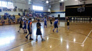The Wildcats set up on offense against the Gym Rats D